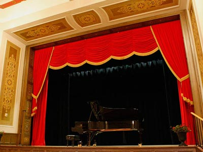 View of Stage with piano in Veda Zuponcic Auditorium in A