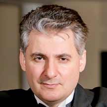 Headshot of Edisher Savistski